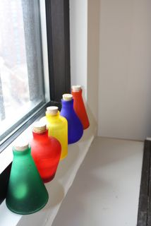 Pretty bottles on window sill